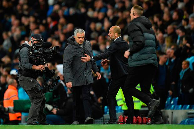 Jose Mourinho (L) and Pep Guardiola embrace at the final whistle. Photo: AFP/Getty Images