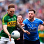 Darran O'Sullivan of Kerry is tackled by Philly McMahon of Dublin during the League final