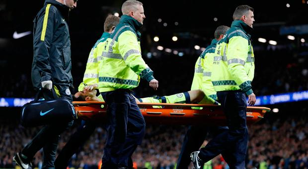 Manchester City's Claudio Bravo is stretchered off