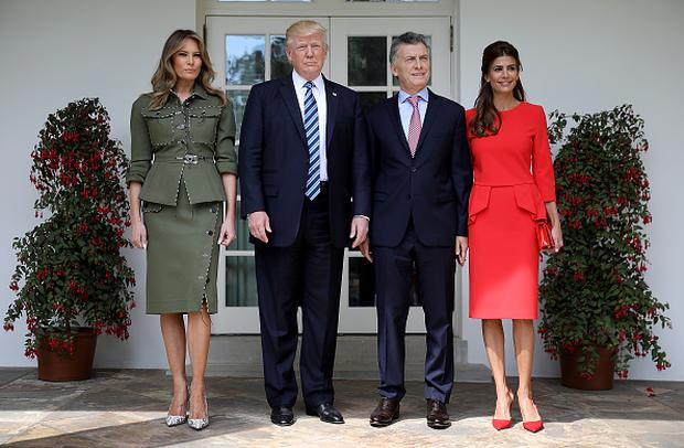 U.S. President Donald Trump and first lady Melania Trump (L) welcome President Mauricio Macri of Argentina and the first lady of Argentina, Juliana Awada (R), to the White House shortly before meeting in the Oval Office April 27, 2017 in Washington, DC. Trump is scheduled to meet with Macri throughout the morning and early afternoon to discuss a range of bilateral issues. (Photo by Win McNamee/Getty Images)