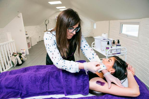 Louise Kelly applying Wax at Waxperts, pictured at their offices in Dun Laoghaire.