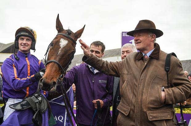 Dublin , Ireland - 28 April 2017; Jockey Patrick Mullins, left, and trainer Willie Mullins, right, with Wicklow Brave after winning the BETDAQ Punchestown Champion Hurdle at Punchestown Racecourse in Naas, Co. Kildare. (Photo By Seb Daly/Sportsfile via Getty Images)