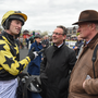 Jockey Patrick Mullins, left, and trainer Willie Mullins in discussion after winning the Tattersalls Ireland Champion Novice Hurdle with Bacardys at Punchestown Racecourse in Naas, Co. Kildare. Photo by Seb Daly/Sportsfile