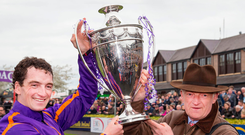 Willie Mullins with Jockey Patrick Mullins after The BETDAQ Punchestown Champion Hurdle of €250,000 at Punchestown yesterday. Photo: Colin O'Riordan