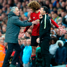 Jose Mourinho tries to calm down Marouane Fellaini after he was shown a red card during the game against Manchester City on Thursday - Mourinho later blames Sergio Aguero for the incident. Photo: Martin Rickett/PA