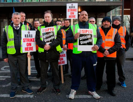 Bus Éireann workers on pickets earlier this month Photo: Gareth Chaney, Collins