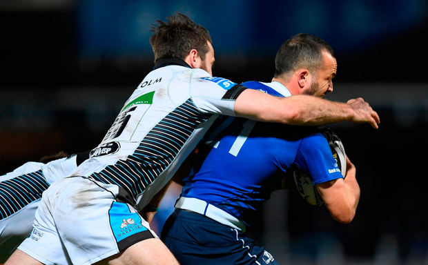 Jamison Gibson-Park of Leinster is tackled by Tommy Seymour of Glasgow Warriors. Photo by Stephen McCarthy/Sportsfile