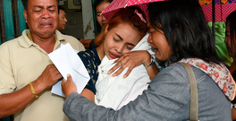 Jiranuch Triratana, centre, holds the body of her 11-month-old daughter Natalie, who was killed by her father who broadcast the murder on Facebook Photo: REUTERS