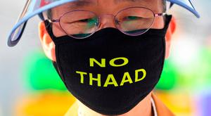 "A protester near the US embassy in Seoul wears a face mask reading ""No THAAD"" during a rally against the deployment of the US Terminal High Altitude Area Defense (THAAD) system in South Korea. Photo: Getty Images"