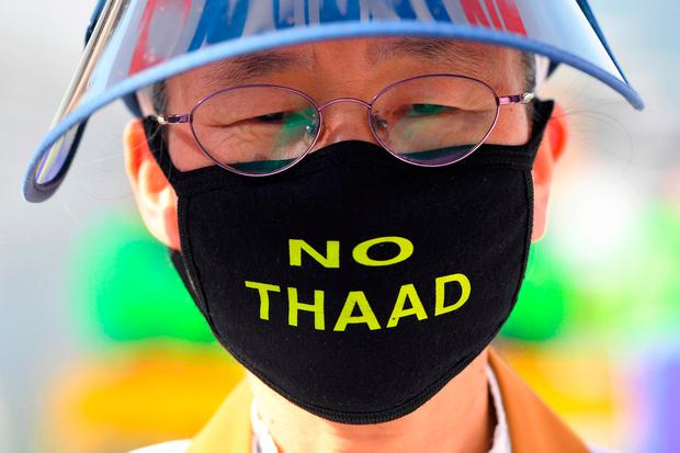 """A protester near the US embassy in Seoul wears a face mask reading """"No THAAD"""" during a rally against the deployment of the US Terminal High Altitude Area Defense (THAAD) system in South Korea. Photo: Getty Images"""