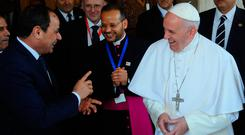 Egyptian President Abdel Fattah al-Sisi meets Pope Francis on his arrival in Cairo, Egypt. Photo: Reuters