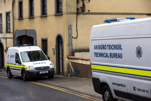 Gardaí outside an apartment in Waterford City where a woman's body was discovered on Friday (Image: Mark Condren)