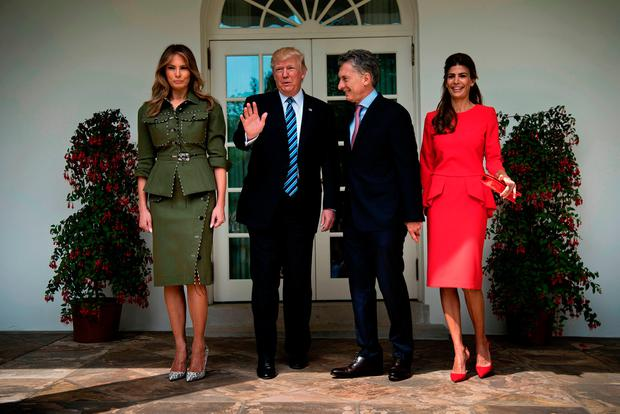(L-R)US First Lady Melania Trump, US President Donald Trump, Argentina's President Mauricio Macri, and Argentina's First Lady Juliana Awada pose outside the West Wing of the White House April 27, 2017 in Washington, DC. / AFP PHOTO / Brendan SmialowskiBRENDAN SMIALOWSKI/AFP/Getty Images