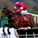 Apple's Jade and Bryan Cooper clear the last on their way to winning the Irish Stallion Farms E.B.F. Mares Champion Hurdle during day five of the Punchestown Festival