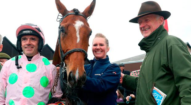 Ruby Walsh with trainer Willie Mullins following victory in the AES Champion Four Year Old Hurdle (Grade 1) (Class 1) aboard Bapaume during day five of the Punchestown Festival