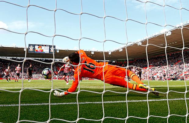 Eldin Jakupovic of Hull City saves a penalty from Dusan Tadic of Southampton during the Premier League match between Southampton and Hull City at St Mary's Stadium on April 29, 2017 in Southampton, England. (Photo by Julian Finney/Getty Images)