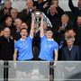 The President of Ireland Michael D. Higgins applauds as the Dublin captains Con O'Callaghan, left, Cillian O'Shea lift the cup after the EirGrid All-Ireland U21 Football Final match between Dublin and Galway at O'Connor Park in Tullamore, Dublin. Photo by Ray McManus/Sportsfile