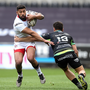 Charles Piutau of Ulster is tackled by Kieron Fonotia of Ospreys during the Guinness PRO12 Round 21 match between Ospreys and Ulster at Liberty Stadium in Swansea, Wales. Photo by Ben Evans/Sportsfile