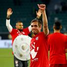 Philipp Lahm of Bayern celebrates after winning the German Championship after winning 6-0 the Bundesliga match between VfL Wolfsburg and Bayern Muenchen at Volkswagen Arena on April 29, 2017 in Wolfsburg, Germany. (Photo by Christof Koepsel/Getty Images for MAN)