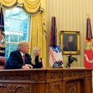 Family team: US president Donald Trump and his daughter Ivanka talk via video conference with International Space Station Commander Peggy Whitson and Jack Fischer on the Space Station last Monday, from the Oval Office of the White House Photo: AP Photo/Susan Walsh