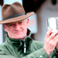 Trainer Willie Mullins with the Irish Champion Trainer trophy during day five of the Punchestown Festival in Naas. Photo: Brian Lawless/PA Wire