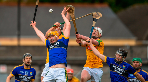 Kerry's Brendan O'Leary and Maurice O'Connor in action against Meath's Joe Keena and Cormac Reilly during the match at Páirc Tailteann. Photo: Matt Browne/Sportsfile
