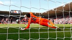 Eldin Jakupovic saves a penalty from Dusan Tadic of Southampton at St Mary's to help edge Hull closer to safety. Photo: Julian Finney/Getty Images