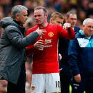 Manchester United manager Jose Mourinho speaks with Wayne Rooney