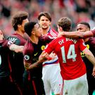 Tempers flare between Manchester City's Gabriel Jesus (centre) and Middlesbrough's Marten de Roon after a penalty is awarded to Manchester City