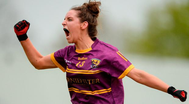 Aisling Murphy of Wexford celebrates scoring her side's second goal during