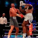 Anthony Joshua catches Wladimir Klitschko with a devastating uppercut during Saturday's fight at Wembley. Photo by Richard Heathcote/Getty Images