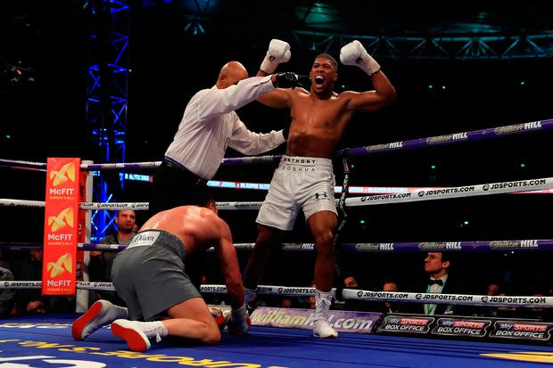 Anthony Joshua (White Shorts) puts Wladimir Klitschko (Gray Shorts) down in the 5th round. Photo by Richard Heathcote/Getty Images