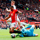 United's Marcus Rashford is fouled by Swansea City goalkeeper Lukasz Fabianski for a penalty at Old Trafford. Photo:: Martin Rickett/PA