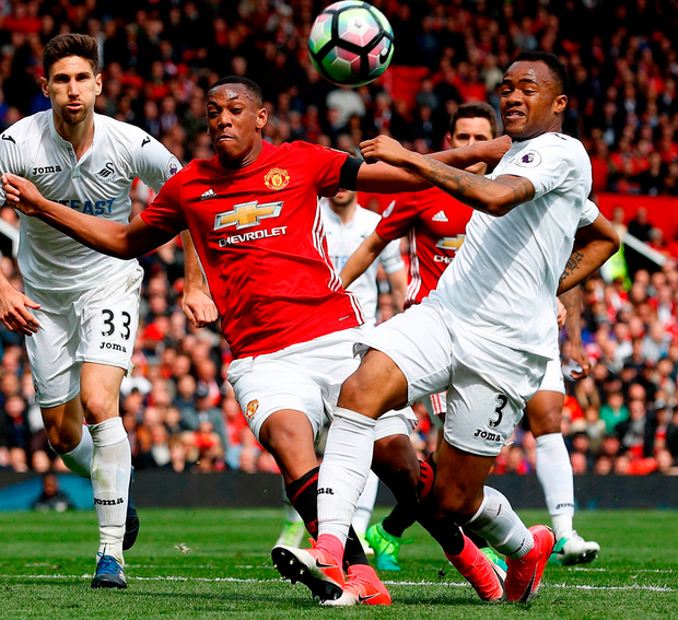 Manchester United's Anthony Martial (left) and Swansea City's Jordan Ayew (right) battle for the ball. Photo: Martin Rickett/PA