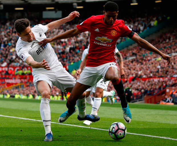 Manchester United's Marcus Rashford battles with Swansea City's Federico Fernandez. Photo: Andrew Yates/Reuters