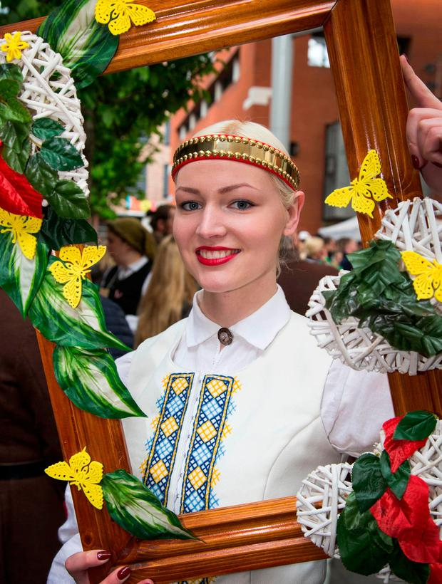Beatrise Leikuca, from Blanchardstown in Dublin, wears a traditional costume at the Latvian Cultural Day in Temple Bar. Photo: Colin O'Riordan