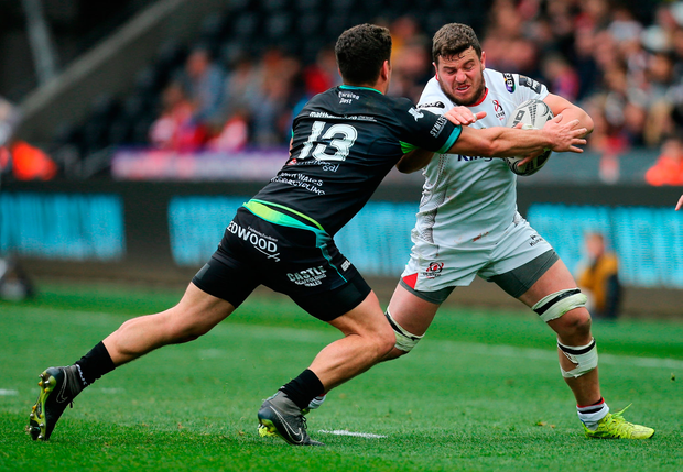 Sean Reidy of Ulster in action against Kieron Fonotia of Ospreys. Photo by Gareth Everett/Sportsfile