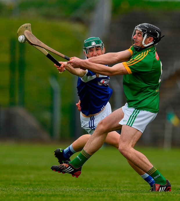 Anthony Forde of Meath clears under pressure from Seán Downey of Laois. Photo by Ray McManus/Sportsfile