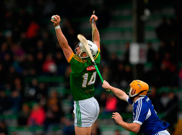 Mark O'Sullivan of Meath in action against Dwane Palmer of Laois. Photo by Ray McManus/Sportsfile