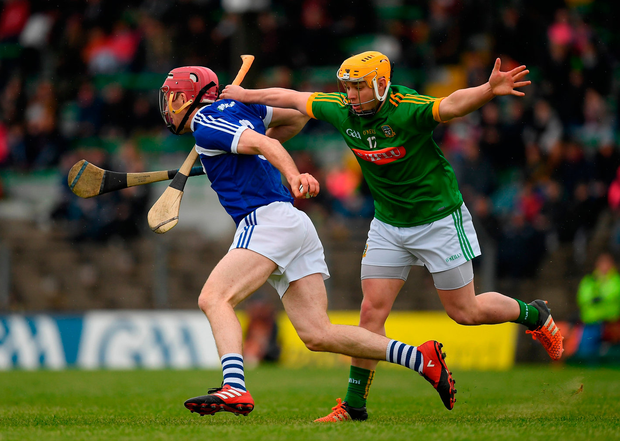 Ciarán Collier of Laois in action against Neil Heffernan of Meath. Photo by Ray McManus/Sportsfile