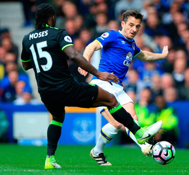 Chelsea's Victor Moses and Everton's Leighton Baines battle for the ball during the Premier League match at Goodison Park. Photo: Nigel French/PA