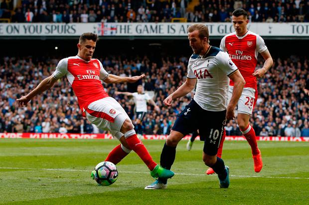 Tottenham's Harry Kane is brought down by Arsenal's Gabriel Paulista for a penalty. Photo: Paul Childs/Reuters