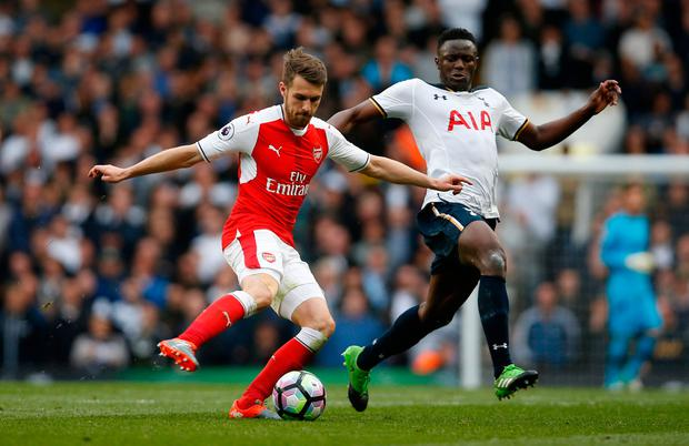 Arsenal's Aaron Ramsey in action with Tottenham's Victor Wanyama. Photo: Paul Childs/Reuters