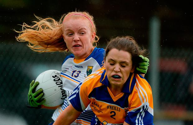 Ciara Byrne of Wicklow in action against Sinéad Hughes of Longford. Photo by Stephen McCarthy/Sportsfile