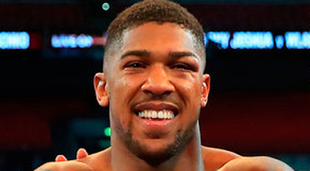 Anthony Joshua celebrates after victory over Wladimir Klitschko at Wembley Stadium. Photo: Richard Heathcote/Getty Images