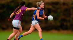 Jennifer Grant of Tipperary in action against Niamh Mernagh of Wexford. Photo by Piaras Ó Mídheach/Sportsfile