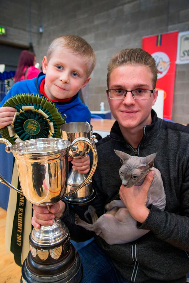 Gustas Dovainys and his brother Matas with his champion Sphynx cat Liala. Photo: Colin O'Riordan