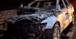 A view of a burnt jeep abandoned by the suspects Photo: DHA/Handout via Reuters TV