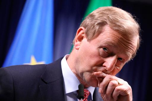 Irish Prime Minister Enda Kenny listens to questions during a media conference at an EU summit in Brussels. (AP Photo/Olivier Matthys)