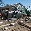 An overturned vehicle rests on the ground surrounded by debris in Canton, Texas, Sunday, April 30, 2017 after tornadoes hit the area the previous night (Sarah A. Miller/Tyler Morning Telegraph)